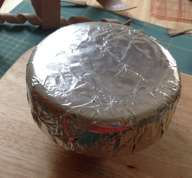 Hat block covered in kitchen foil