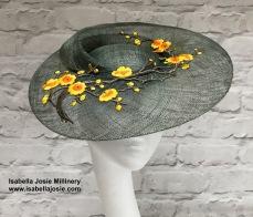 Dark Green Swirl Ascot Hat with Yellow Blossom Trim by Isabella Josie Bespoke Millinery