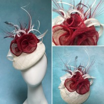 Ivory and red cocktail hat designed for Buckingham Palace ceremony by Isabella Josie Millinery